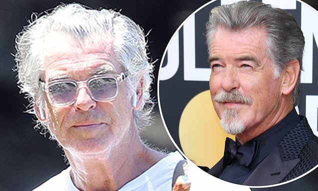 Pierce Brosnan cuts a laid back figure as he goes on a solo hike while self-isolating in Hawaii