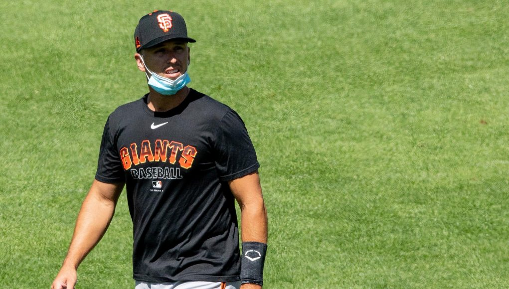 Giants' Buster Posey arrives in camp but says he still might opt out