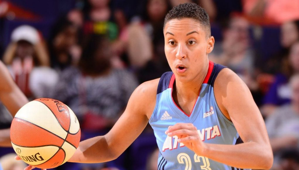 WNBA players wearing T-shirts opposing Dream owner