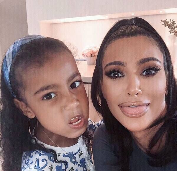 "Watch Kim Kardashian Plead With North West to ""Be Quiet"" in Her Latest Makeup Tutorial"