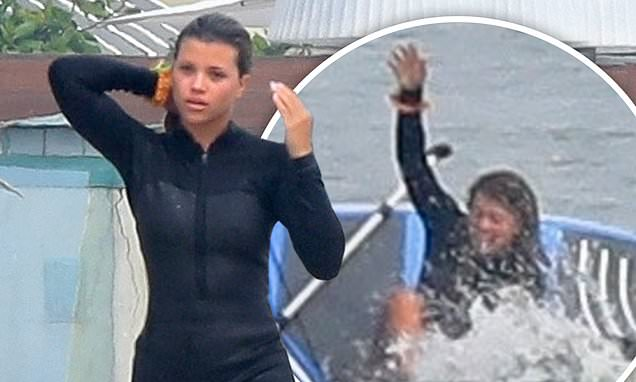 Sofia Richie dons a short wetsuit as she wipes out while paddleboarding…after Scott Disick split