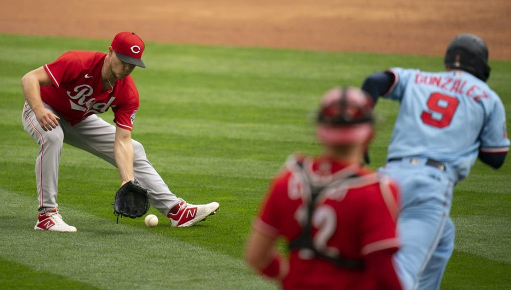 Twins lose to Reds 5-3, but repeat as AL Central Division champions and will face Houston